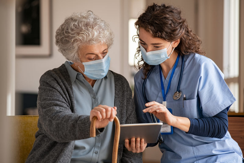 Doctor,And,Senior,Woman,Going,Through,Medical,Record,On,Digital